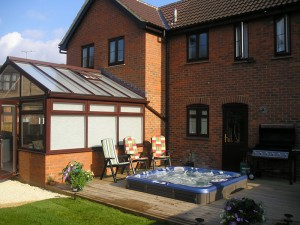 Rear of property at completion of extension, conservatory and landscaping