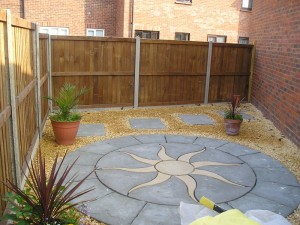 Landscaping and fencing at side of new extension